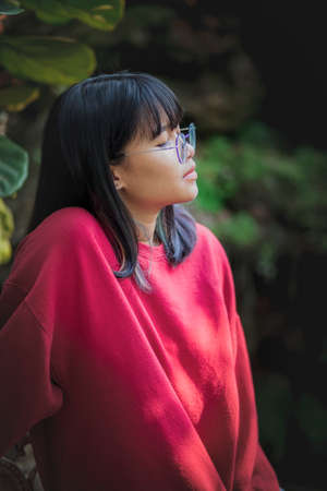portrait of asian teenager wearing eyeglasses standing outdoor Stock fotó
