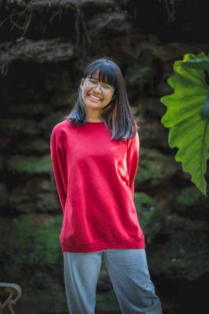 portrait of asian teenager wearing eyeglasses standing outdoor Stock fotó
