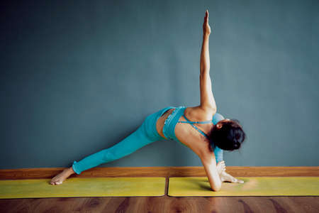 woman doing yoga in home living room