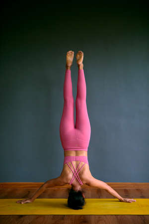 woman doing head standing yogo pose Stock fotó