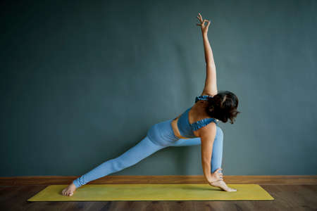 woman doing yoga pose at home living room Stock fotó