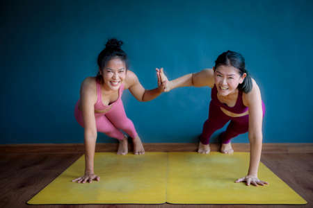 two asian woman doing yoga with happiness Stock fotó
