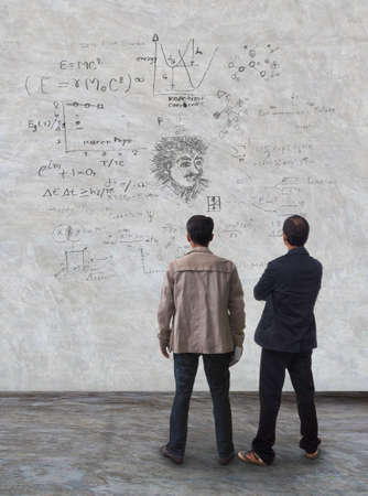 two man standing and watching formula on wall use for multipurpose Sajtókép