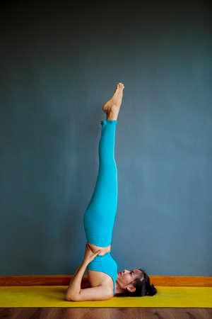 asian woman doing yoga pose at home living room