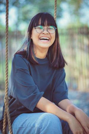 asian teenager laughing with happiness mood on location