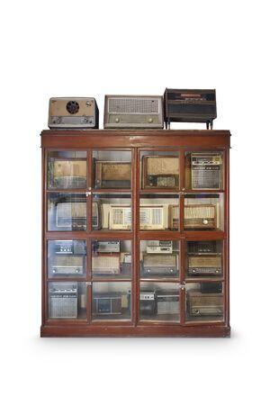 Retro radio on cabinet isolated on white background