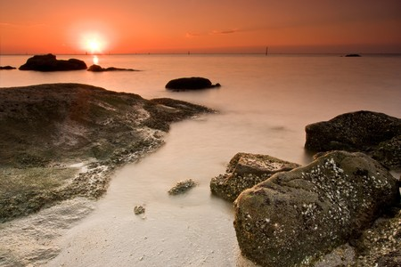 distantly: sunset and soft sea in tropical zone