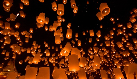 plentifully: many lamp float in sky at night