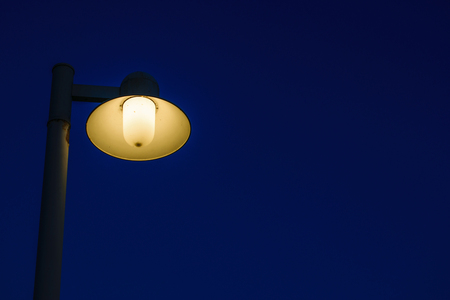 Edison lamp on wayside in countryside at night