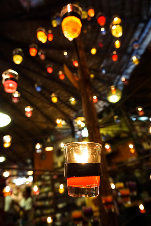burning love: abstract, background, ball, beautiful, blur, box, bright, burning, candle, candlelight, celebration, christmas, church, color, dark, decoration, design, festive, fire, flame, focus, gift, glitter, glow, glowing, happy, holiday, home, house, light, love, m Stock Photo