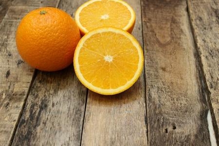 woodenrn: Fresh orange on the wooden background