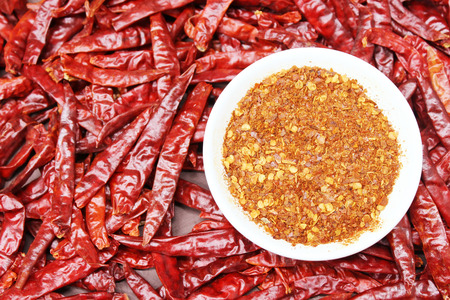 red chillies with red chilly powder Stock Photo