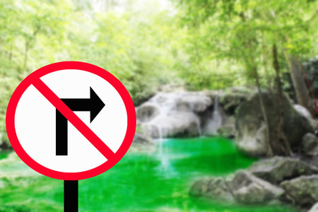 to decide: Road signs.Do Not Turn Right - Form in Road Sign,waterfall background Stock Photo
