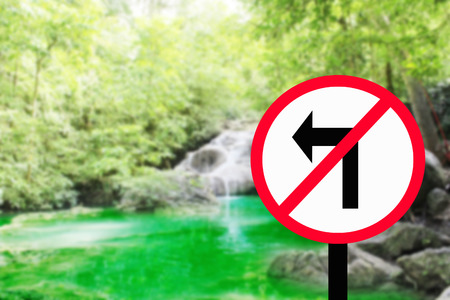 pointed arrows: Road signs.Do Not Turn left - Form in Road Sign,waterfall background