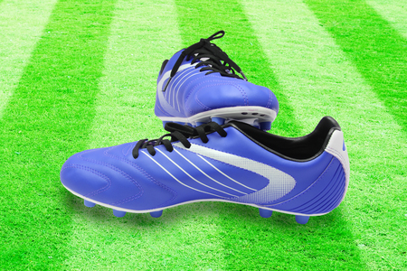 football boots: Football boots on the grass field