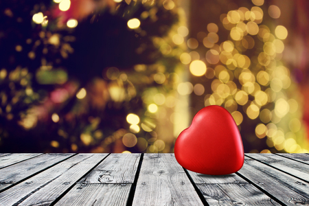 Red heart on wooden table with christmas light night,abstract circular bokeh background Stock Photo