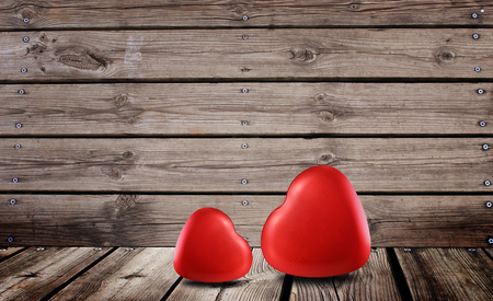 Red hearts symbol of love on the wooden background for valentine day
