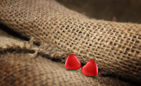 Red hearts symbol of love on the sack background for valentine day