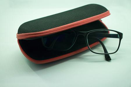 sunglasses opened case on white background