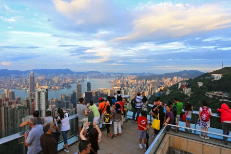 HONG KONG - JULY 19 : Tourists visit the Peak Tower on July 19, 2012 in Hong Kong. The Peak is the most popular attraction in Hong Kong, provides magnificent view of the city.