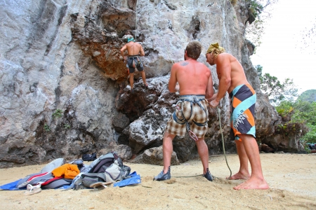 KRABI, THAILAND - JANUARY 25 : Unidentified rock climbing instructor gives lessons to his students on January 25, 2011 in Krabi, Thailand. Rock climbing in Krabi becomes popular over recent years.