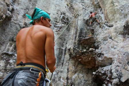 KRABI, THAILAND - JANUARY 25 : Unidentified rock climbers during a climbing session on January 25, 2011 in Krabi, Thailand. Rock climbing in Krabi becomes popular over recent years.