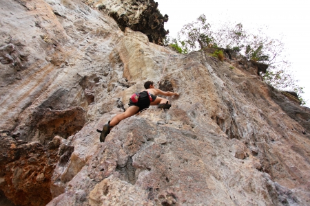 KRABI, THAILAND - JANUARY 25 : Unidentified rock climber during a climbing session on January 25, 2011 in Krabi, Thailand. Rock climbing in Krabi becomes popular over recent years.