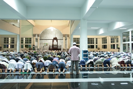 bowing: Muslim devotees mass prayer at Central Mosque in Krabi, Thailand Editorial