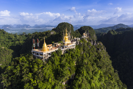 sua: Aerial view of Tiger Cave Temple or Wat Thum Sua at Krabi province, Thailand. At the top of the mountain there is a large golden Buddha statue which is a popular tourist attraction.