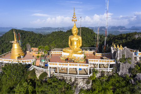 Aerial view of Tiger Cave Temple or Wat Thum Sua at Krabi province, Thailand. At the top of the mountain there is a large golden Buddha statue which is a popular tourist attraction.