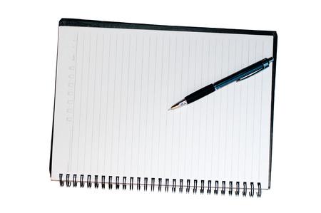 Pen in notebook photo