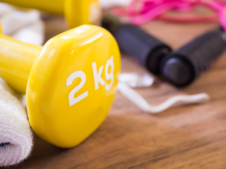 Exercise equipment on wood background for good healthy