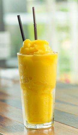 Mango smootie with green background