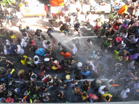 silom: BANGKOK, THAILAND - APRIL, 2010: people playing water in Songkran festival at Silom Road in Bangkok. Editorial