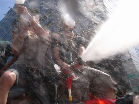 silom: BANGKOK, THAILAND - APRIL, 2012: people playing water in Songkran festival at Silom Road in Bangkok.