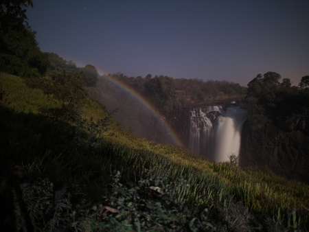Lunar rainbow in Victoria Falls from Zimbabwe side Stock Photo