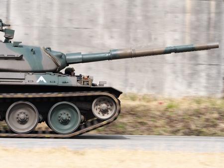 panning shot: panning shot of moving tank