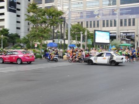 People ride quadruple near Silom street carrying water guns during Songkran Editorial