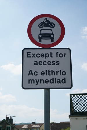 Road sign showing except for access  written in Welsh and English