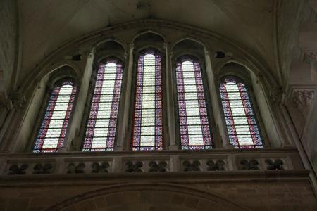 lintel: Vezelay, France-November, 19, 2016: Stained-glass windows of Basilica Sainte-Marie-Madeleine in Vezelay