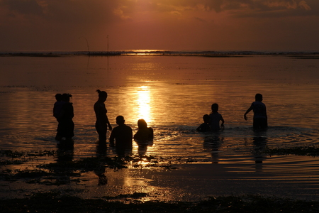 People at Sanur beach in the morning