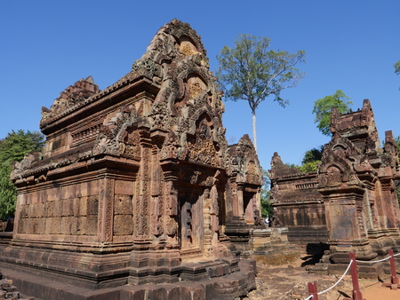 Siem Reap, Cambodia-December 23, 2017: Banteay Srei is a 10th-century Cambodian temple dedicated to the Hindu god Shiva. It is renowned for its intricate decoration carved in pinkish sandstone that covers the walls like tapestry.