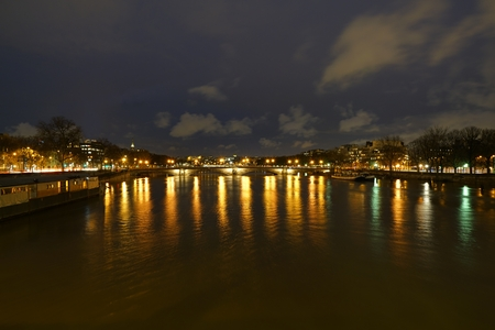 Paris, France-January 25, 2018: View of the Saine river and Pont des Invalides from Pont Alexandre III