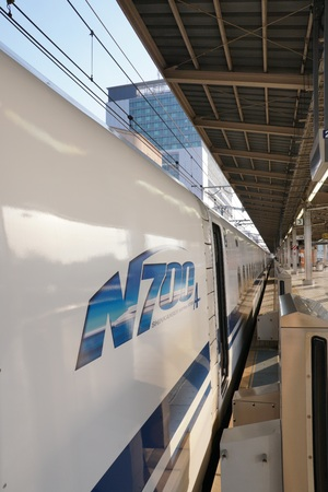 Kanagawa, Japan-May 11, 2018: The first bullet train or Tokaido Shinkansen Hikari departing from Shin-Yokohama station in th e morning