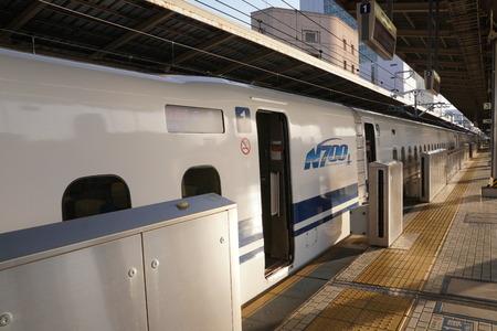 Kanagawa, Japan-May 11, 2018: The first bullet train or Tokaido Shinkansen Hikari departing from Shin-Yokohama station in th e morning