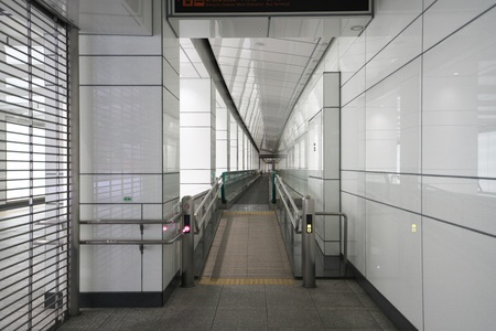 Tokyo, Japan-June 3, 2018: A moving walkway or moving sidewalk is installed along the underground street in Shinjuku. It stops the operation early in the morning.