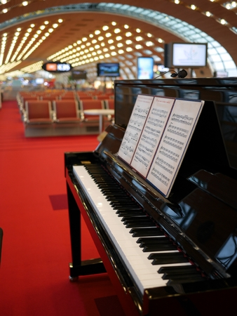 A piano at an airport lobby