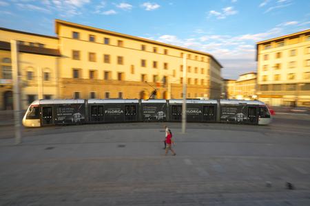 Firenze, Italy-July 27, 2018: A tram passes near Firenze Santa Maria Novella station, Firenze, Italy Editorial