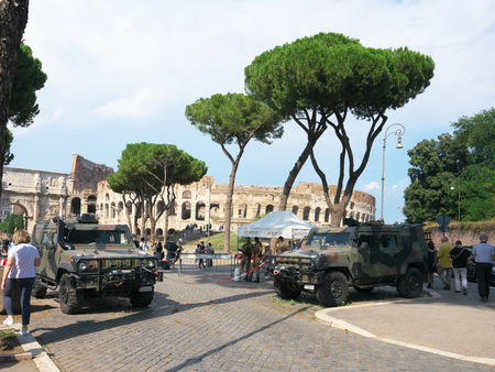 Rome, Italy-July 27, 2018: Highly-guarded Colosseum or Coliseum in Rome