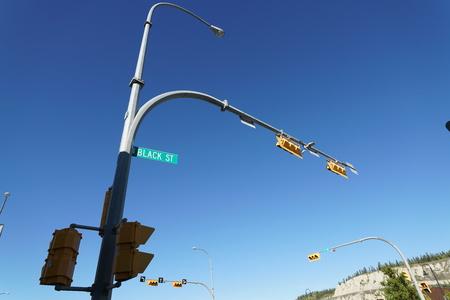 Whitehorse, Canada-September 10, 2018: Traffic light at Black street in Whitehorse on blue sky background Stock Photo